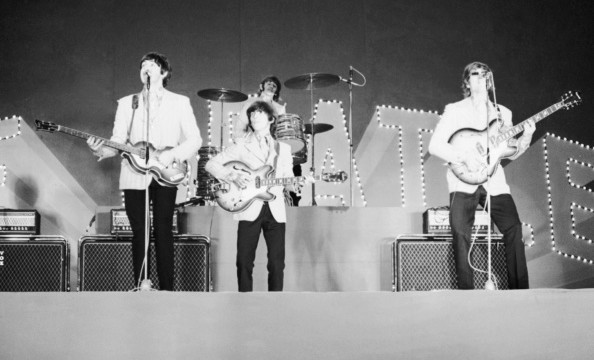The Beatles on stage at Tokyo?s Budokan Hall. Japan, 2nd July 1966. From left to right, Paul McCartney, George Harrison, Ringo Starr, John Lennon. (Photo by Robert Whitaker/Getty Images)