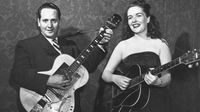 FILE - In this Nov. 5, 1951 file photo, Les Paul and his wife, Mary Ford, perform with their guitars. Paul, 94, the guitarist and inventor who changed the course of music with the electric guitar and multitrack recording and had a string of hits, died, Thursday, Aug. 13, 2009 in White Plains, N.Y., according to Gibson Guitar. (AP Photo, file)